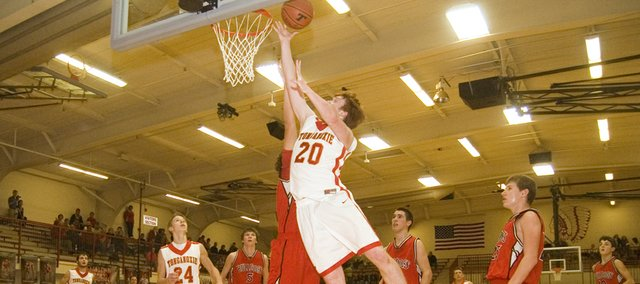 Tonganoxie High center Dane Erickson gets to the rim for a layup in the second half of the Chieftains' 47-29 defeat of Anderson County on Friday.