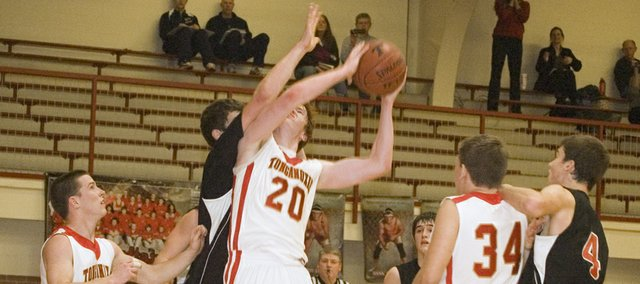 Tonganoxie High junior center Dane Erickson draws a foul against Metro Academy with 15 seconds left on Monday night. Erickson hit two free throws to help the Chieftains win, 57-56.
