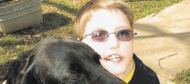 "One of Bryce Dudgeon's favorite ""people"" is his dog, Carl. Bryce will celebrate his 10th birthday Dec. 27, beating the odds for those with Tetralogy of Fallot, a heart defect he has had since birth."