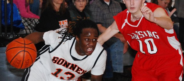 Bonner Springs junior guard Jourdaine Smallwood drives to the basket during the Braves' loss to Lansing.