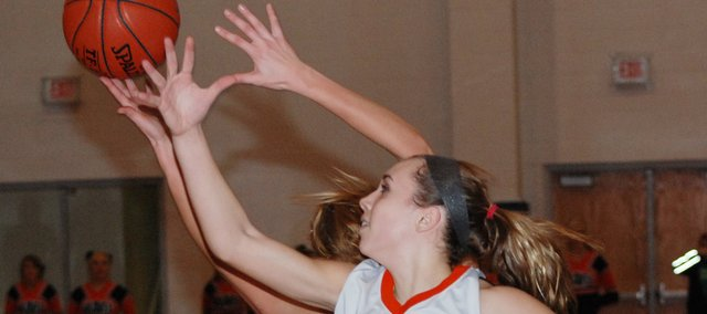 Bonner Springs sophomore Haley Hoffine tries to pull in a rebound during the Braves' loss to Lansing.