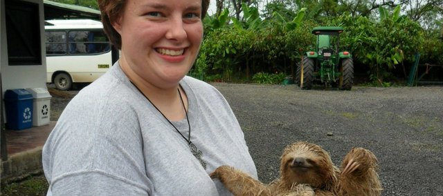 Chelsea Simmons holds a baby sloth while visiting an organic cocoa farm in Costa Rica. Simmons, a Bonner Springs High School graduate, studied Spanish and culture in a study-abroad program there during the fall semester