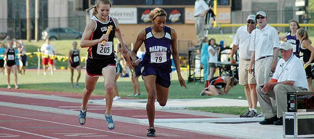 Baldwin High School senior JaBryanna Wellington, right, leans past Colby's Emilea Finley at the finish line to win the 1,600-meter relay Saturday evening. The victory gave the BHS girls' team their first-ever Class 4A state championship.