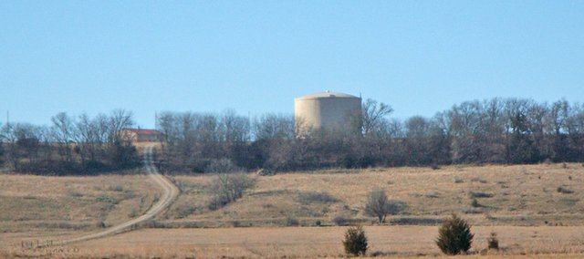 The water storage tank of Suburban Water positions the private utility to provide water service to the city of Tonganoxie's 237-acre undeveloped industrial park south of the city. Suburban Water will present three options to the council at a special meeting next week that would make the utility a partner in water service to the park.