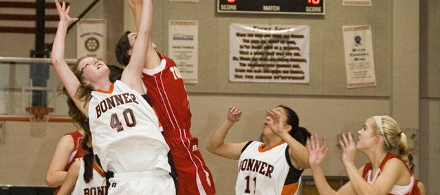 Bonner Springs sophomore Anna Deegan battles Tonganoxie sophomore Jenny Whitledge for a rebound late in the Braves' 59-45 win on Tuesday.