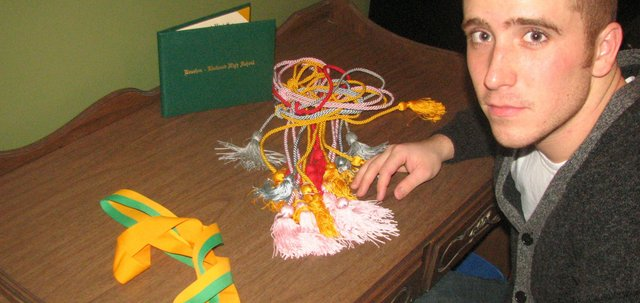 Lucas Turner displays the cords and medals he wore at his  Basehor-Linwood High School graduation in 2009, including the medal he won for being a valedictorian. Turner said the accomplishment is still important to him, though he does not talk about it much with people at Creighton University, where he is a sophomore now.