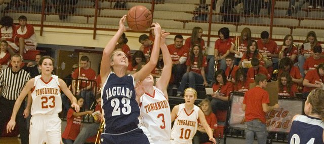 Mill Valley High senior Kelsey Strobel battles Tonganoxie junior Haley Smith for a rebound in the second quarter of the Jaguars&#39; 52-28 road win on Friday night.