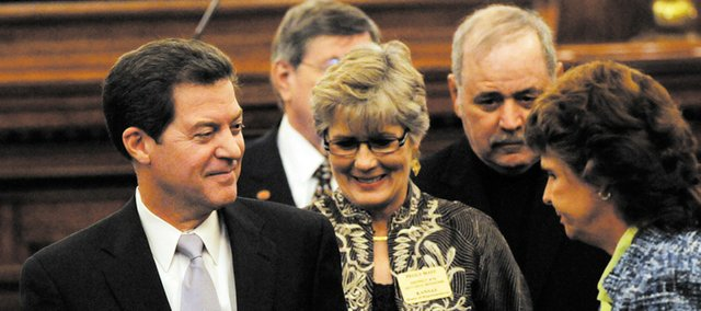 Kansas Gov. Sam Brownback shakes hands with onlookers as he leaves the House chambers after his State Of State address, on Wednesday January 12, 2011.