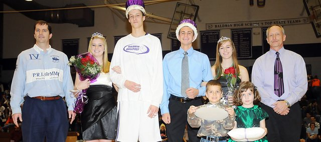 Baldwin High School celebrated its Winter Royalty Friday night. The winners were, from left, Myriah Pippert (queen), Justin Vander Tuig (king), Brian Wright (prince) and Carol Whaley (princess). BHS principals Shaun Moseman, far left, and Bret Jones congratulated the winners.  The crown and scepter carriers were Aaron Gunther and Kaleigh Griffith.