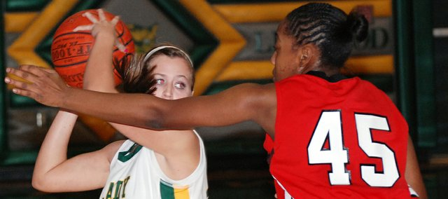 Basehor-Linwood senior Amanda O'Bryan is guarded closely by Park Hill (Mo.) guard Kyleesha Weston during Basehor's 35-32 loss in the first round of the Basehor-Linwood Girls Basketball Invitational.