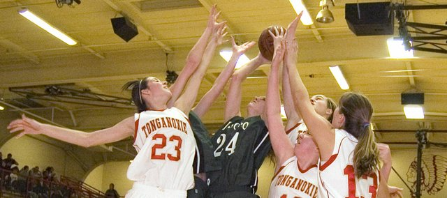 Four Tonganoxie High players try to keep De Soto's Ashley Gorman off the offensive glass in the first half of the Wildcats' 30-29 opening-round victory Tuesday at the Tonganoxie Invitational.