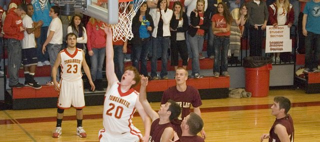 Tonganoxie High center Dane Erickson goes up for a lay-in in the second quarter of the Chieftains' 55-40 first-round loss to Silver Lake Tuesday at the Tonganoxie Invitational.