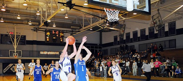 Baldwin High School freshman Chad Berg attacks the basket for a layup during the third quarter Tuesday. Berg scored a team-high 15 points help the Bulldogs defeat Kansas City Christian 50-45 in the first round of the Baldwin Invitational Tournament.