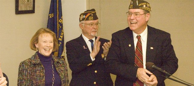 Kathy Walker receives gifts for being named the Kansas VFW Teacher of the Year at a ceremony Monday at the Tonganoxie VFW Post Home. Looking on are Post Commander Galen Freeman and fellow VFW member Larry Meadows.