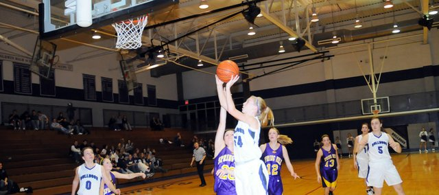 Baldwin High School sophomore Monica Howard scores a layup Friday night against Spring Hill. BHS lost the game, 70-46.