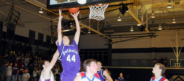 Baldwin High School senior Justin Vander Tuig scores two of his game-high 25 points Friday night. BHS defeated Wellsville 55-44 to advance to the Baldwin Invitational Tournament championship game at 4 p.m. Saturday.