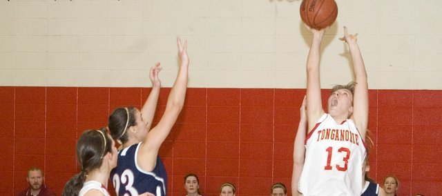 Tonganoxie High freshman forward Emma Stilgenbauer goes up for an easy hoop in the Chieftains' 43-26 defeat of Eudora Saturday morning in the seventh-place game at the Tonganoxie Invitaional.