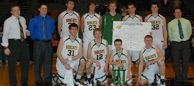 The Basehor-Linwood boys basketball team held off Park Hill (Mo.), 53-45, and the Bobcats captured their fourth straight Basehor-Linwood Boys Basketball Invitational championship.