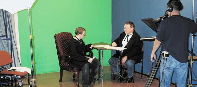"Matthew Marshall (left), a Kansas City Kansas Community College student, is filmed in a scene with Joe Vaughan (right), a member of the Wyandotte County Historical Society Board of Directors, as part of ""The Wyandotte Convention 1859: How the Kansas Constitution Led to a Free State."" The short film, which documents the final day of the Wyandotte Convention, will be shown tonight at Kansas City Kansas Community College."