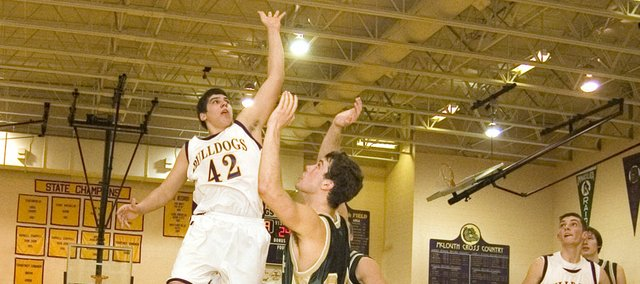 McLouth High junior forward Alen Kramer floats a shot toward the basket in the third quarter of McLouth's Thursday home win against Maranatha Academy. The Bulldogs won 49-46.