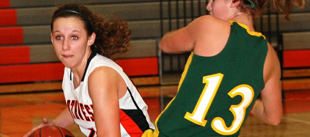 Shawnee Mission Northwest junior point guard Jessica Johnson looks for an open teammate to pass to during the second half of the Cougars' 43-38 victory against Shawnee Mission South.