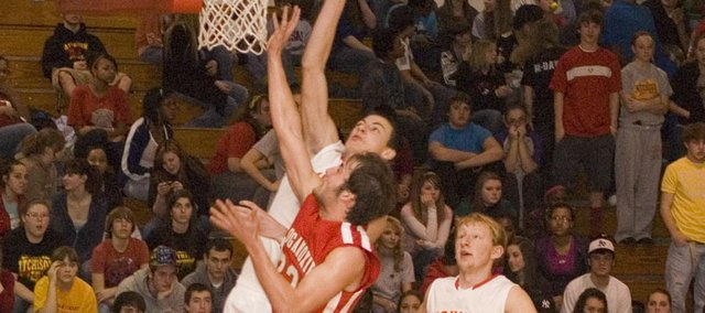 Dylan Scates lays up the basketball Friday at Atchison in the second half of Tonganoxie Highs 85-80 overtime victory. A senior, Scates scored 22 points off the bench for the Chieftains, who won their first road game of the season in their non-conference finale.