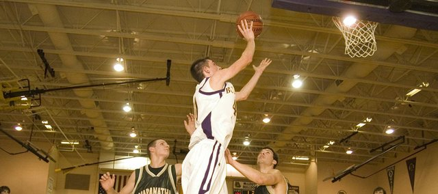 McLouth High junior forward Gavin Swearngin explodes toward the rim in the second half of the Bulldogs 49-46 home victory over Maranatha Academy.