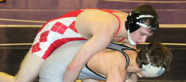Tonganoxie High senior Justin Soetaert attempts to grasp his opponent on Saturday at the Baldwin Invitational. Soetaert (125 pounds) was 3-2 at Baldwin and placed fourth.