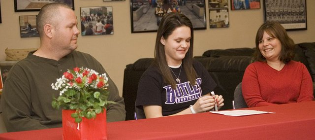 With her parents, Rob and Jen, by her side, Tonganoxie High senior Kaitlyn Wolken signs a letter of intent with the Butler Community College softball program at a Jan. 28 ceremony.