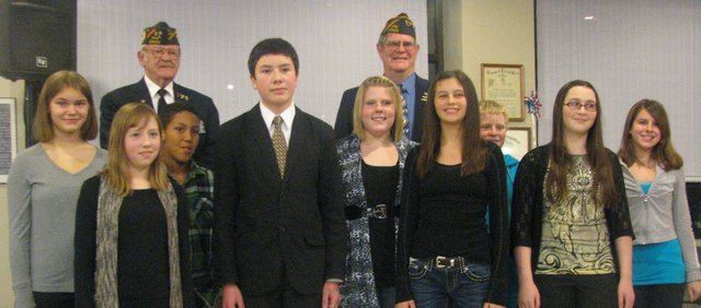 The Basehor VFW Post's Patriot's Pen essay contest winners (front, left to right) Alyssa Bailey, Daniel Tady, Zoey DeLeon, Chandreah Hime, (back, left to right) Michaela Grimes, Isaiah Foley, Alyssa Foster, William Breuer and Marina Wilson gather after reading their winning essays at the Post on Thursday. Not pictured is another winner, Morgan Markovich. In back are post members Fred Box and Daniel Stueckemann. About 400 middle-school students entered the Basehor competition.