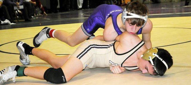 Baldwin High School sophomore Bryce Shoemaker, top, finished second in the 119-pound match Saturday at the Baldwin Invitational Tournament. Shoemaker lost the 119 title to Bo Persel of Lansing, who is the No. 1-ranked Class 5A wrestler.