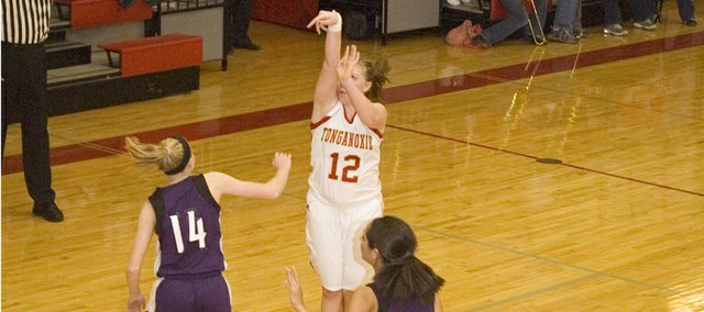Tonganoxie High junior guard Amanda Holroyd releases a 3-pointer in the second quarter of the Chieftains' 49-31 home victory over Piper on Friday. Holroyd hit four 3's in the win and scored 20 points.