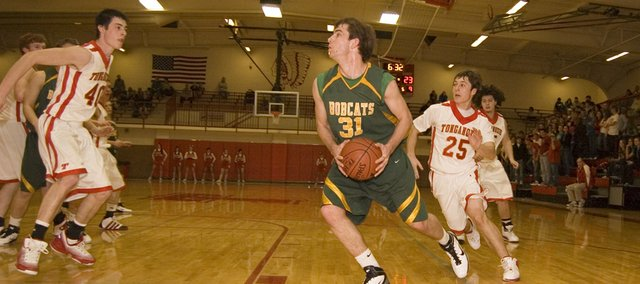 Basehor-Linwood High's Colin Murphy heads to the paint for a layup in the Bobcats' 76-51 vcitory at Tonganoxie on Saturday.