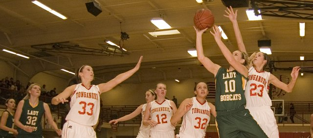 Basehor-Linwood High senior Macyn Sanders cuts to the paint against Tonganoxie on Saturday in the Bobcats&#39; 35-30 road win.