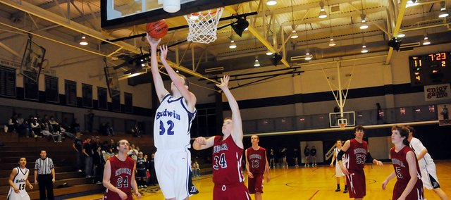 Baldwin High School sophomore Caleb Gaylord (No. 32) scores two of his game-high 12 points to help the Bulldogs beat Eudora 45-26 Tuesday night.