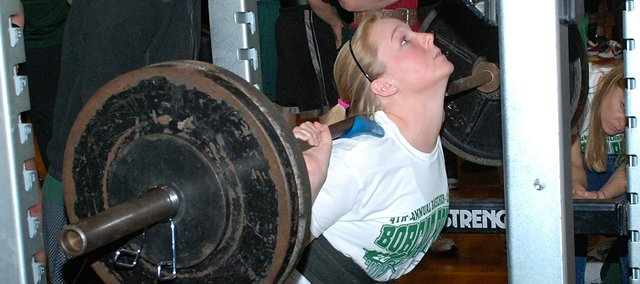 Brittany Billinger of Basehor-Linwood competes in the squat on Saturday at the Bobcat Power Invitational at BLHS. Billinger placed first in her weight division with a lift of 245 pounds. In the process, she helped lead the Basehor-Linwood girls to their 20th consecutive first-place finish in a meet. Included in that streak are three state championships.