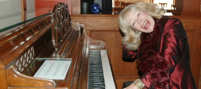 Mimi Carbery almost gave up the piano while a student at Bonner Springs High School, but a lesson with a Kansas City jazz musician spurred Carbery onto a 40-year career that has taken her around the globe.
