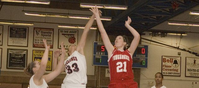 Tonganoxie High senior Tayler Miles goes up for an early score in the Chieftains' 57-53 road loss Friday at Bishop Ward.