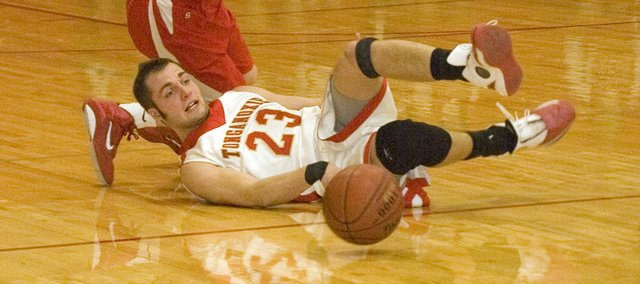 Tonganoxie High senior Dylan Scates was fouled after diving on the floor for a loose-ball steal in the second quarter of the Chieftains' 57-55 defeat of Lansing on Tuesday. THS became the first team in the Kaw Valley League to knock off the Lions  this season.