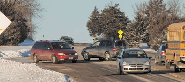 Westbound traffic, including a school bus, attempts to turn south off U.S. Highway 56 on Thursday morning. KDOT has agreed to spend $550,000 to fix the troublesome intersection near Baldwin Elementary School Primary Center at U.S. Highway 56 and East 1600 Road. The project won't start until summer of 2013.