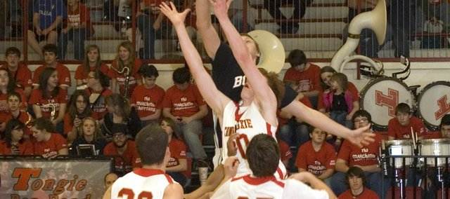 Big men Dane Erickson, Tonganoxie High junior, and Brett Steuart, Bonner Springs junior, battle for a rebound in the first half of the Braves' 52-41 victory Friday at THS.
