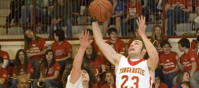 Tonganoxie High's Brennen Williams and Dylan Scates go after a rebound on Friday against Bonner Springs. The Chieftains' postseason will begin next week with a sub-state first-round game against Jeff West.