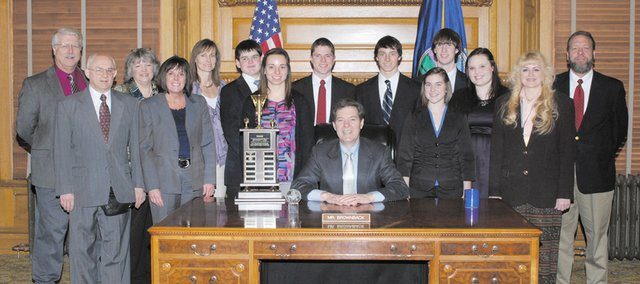 Members of the Baldwin High School Real World Design Team were honored Monday at the Statehouse in Topeka by Gov. Sam Brownback.