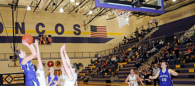 Baldwin High School freshman Katie Jones shoots a jumper over two Spring Hill players. Jones scored six points in the Bulldogs' 53-40 victory Tuesday.