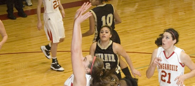 Tonganoxie High senior forward Danielle Miller gets to the basket for a layup in the first quarter of the Chieftains' 72-30 Senior Night win over Turner on Friday.