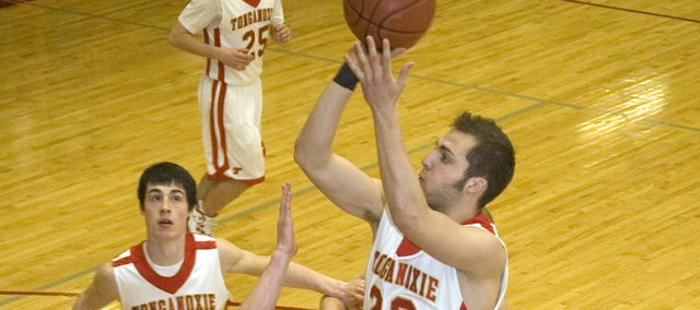 Tonganoxie High senior guard Dylan Scates elevates for a shot attempt as teammate Dylan Jacobs watches in the first quarter of the Chieftains' 79-52 defeat of Jeff West on Monday in the first round of sub-state.