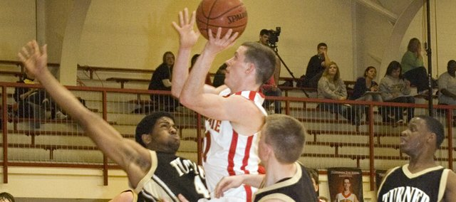 Tonganoxie High senior point guard Jeremy Carlisle draws a foul in the fourth quarter of the Chieftains' 66-55 Senior Night victory over Turner on Friday.