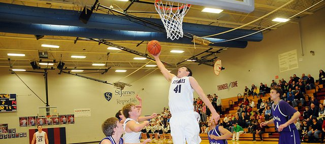 Saint James&#39; Clint McCullough skies for an offensive rebound. He helped lead the Thunder with 18 points as they beat Baldwin 54-43 in the Class 4A sub-state game Monday night. 