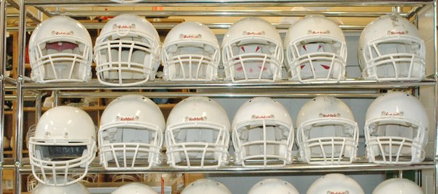 Riddell helmets sit in the Shawnee Mission North football team's equipment room. North coach Dennis Grayless said only 21 of the school's 135 helmets were in the office as the others were being reconditioned. Some parents, such as Tim McCarty, have opted to pay extra for helmets claiming to offer increased protection from concussions.