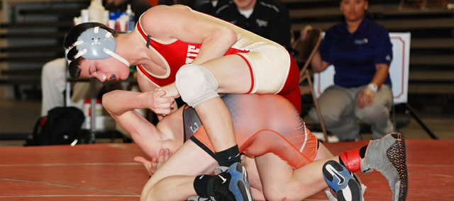 Clayton Himpel grabs his opponent, Abilene High's Junior Morgan, in the 112-pound Class 4A state third-place match on Saturday at the Bicentennial Center in Salina. Himpel, a Tonganoxie freshman, lost the match, 4-2, and took the fourth-place medal at the state tournament.